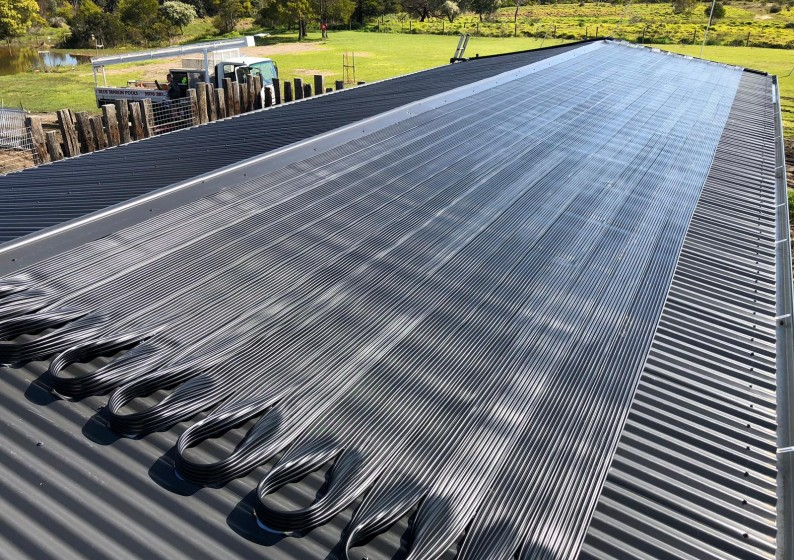 Strip-Solar-Heating-on-Metal-Roof-14-794x560