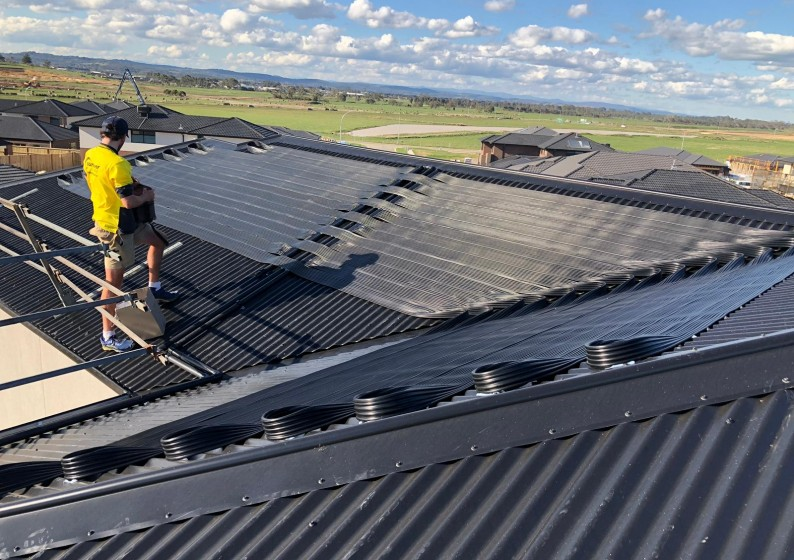 Strip-Solar-Heating-on-Metal-Roof-15-794x560